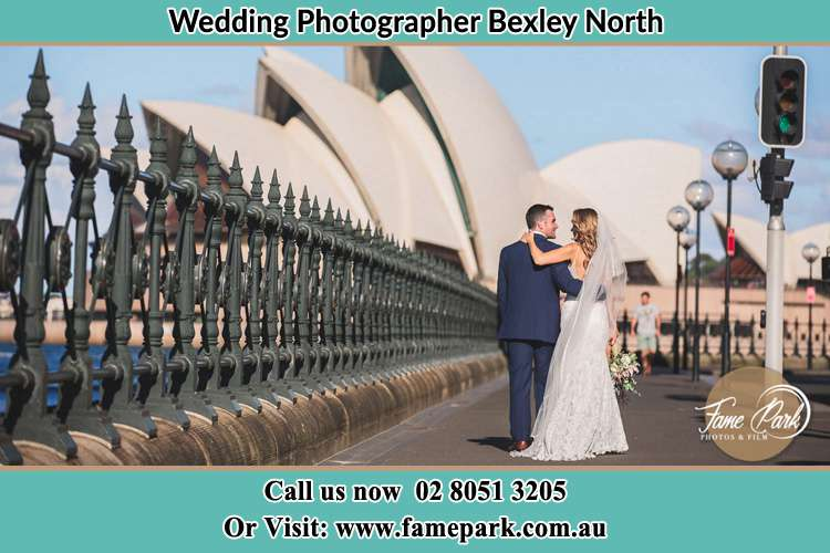 The Groom and the Bride walking towards the Sydney Grand Opera House Bexley North NSW 2207