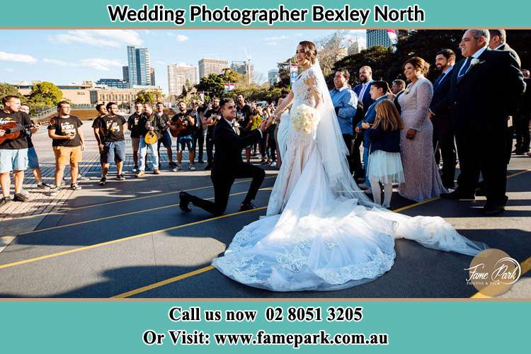 Groom Kneeling down in front of the Bride Bexley North NSW 2207