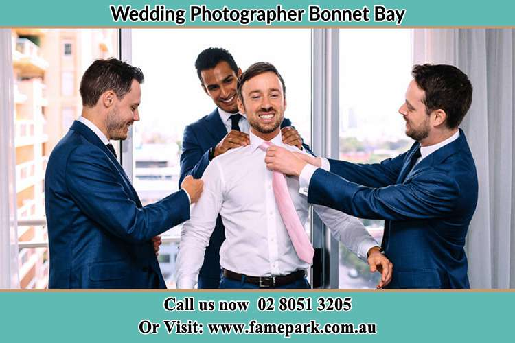 Photo of the Groom helping by the groomsmen getting ready Bonnet Bay NSW 2226