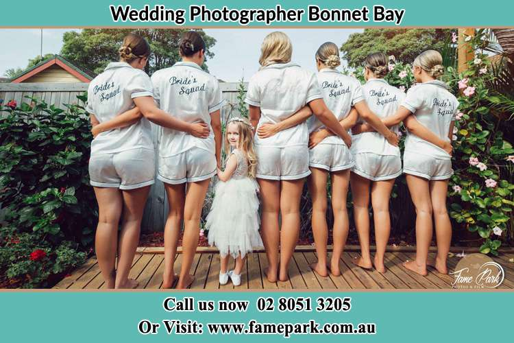 Behind photo of the Bride and the bridesmaids with the flower girl looking back Bonnet Bay NSW 2226