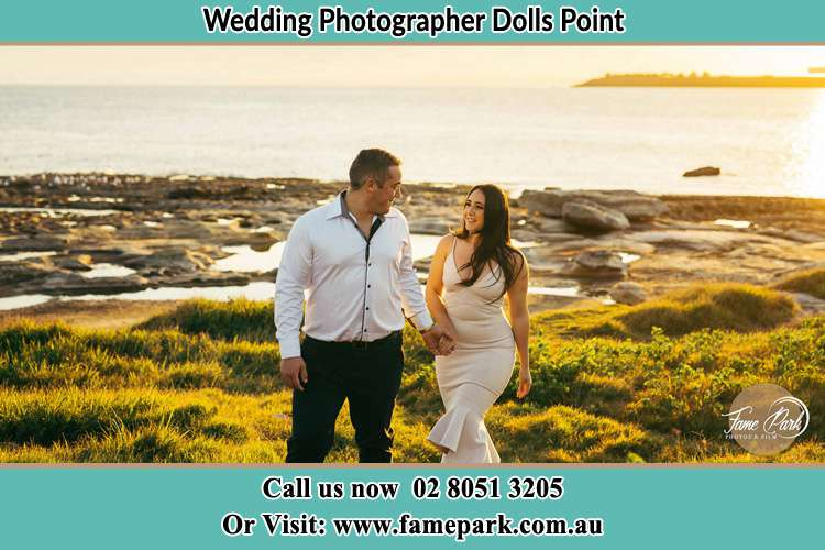 Photo of the Groom and the Bride walking near the lake Dolls Point NSW 2219