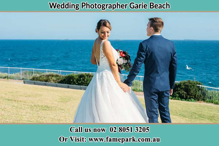 Photo of the Bride and the Groom holding hands at the yard Garie Beach NSW 2233