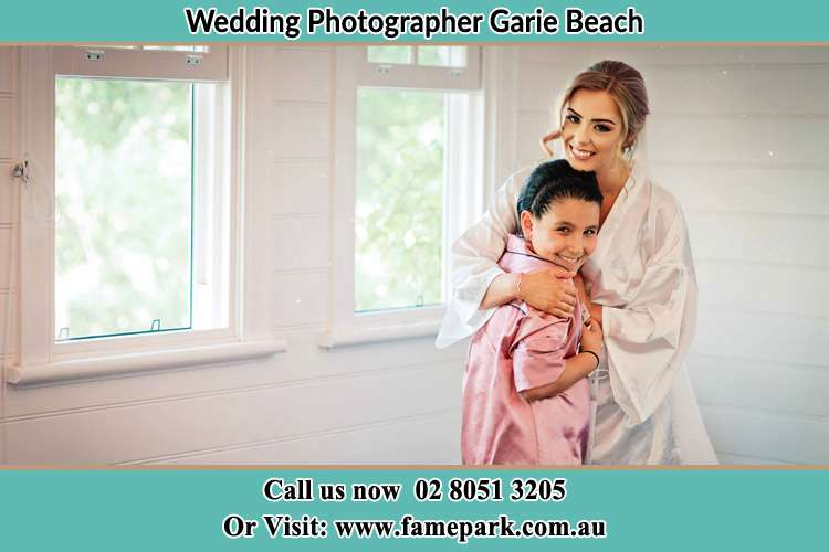 Photo of the Bride hugging the flower girl Garie Beach NSW 2233