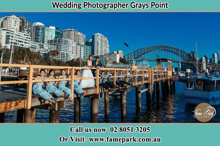 Photo of the Groom and the Bride with the entourage at the bridge Grays Point NSW 2232