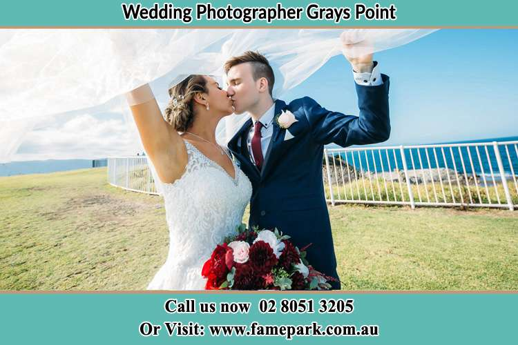 Photo of the Bride and the Groom kissing at the yard Grays Point NSW 2232