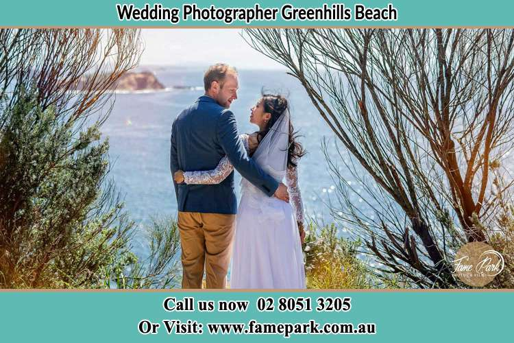Photo of the Groom and the Bride looking each other near the sea front Greenhills Beach NSW 2230
