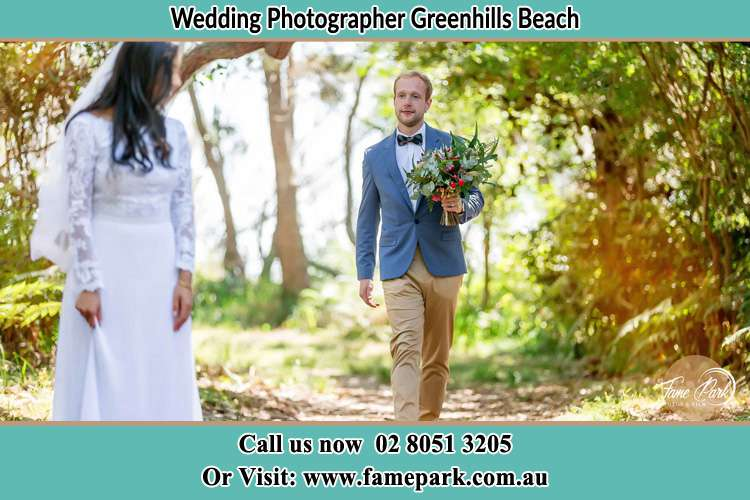 Photo of the Groom bringing flower to the Bride Greenhills Beach NSW 2230