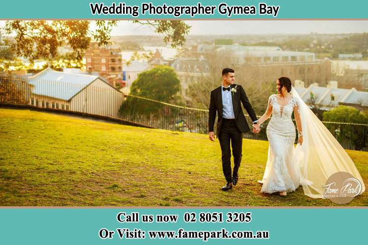 Photo of the Groom and the Bride walking at the yard Gymea Bay NSW 2227