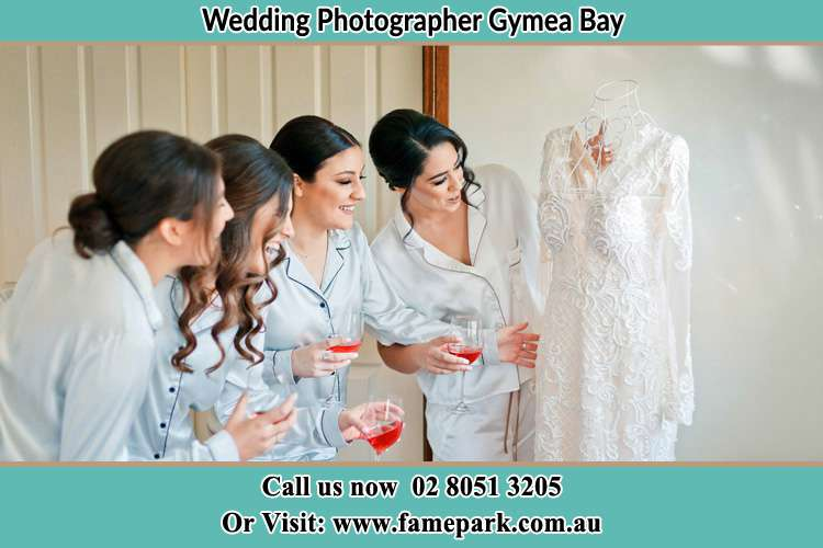Photo of the Bride and the bridesmaids checking the wedding gown Gymea Bay NSW 2227