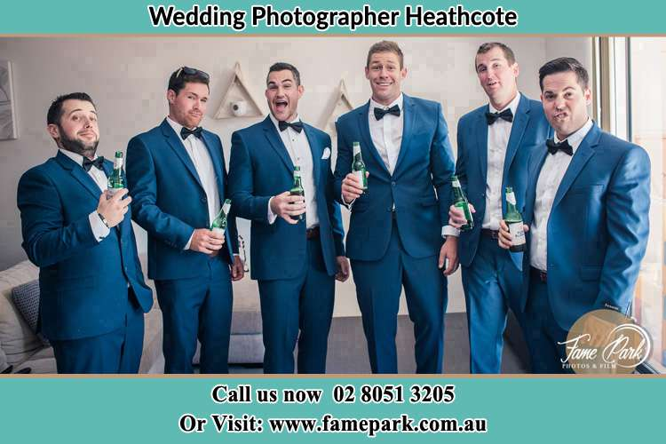 The groom and his groomsmen striking a wacky pose in front of the camera Heathcote NSW 2233