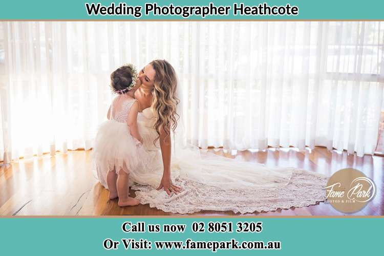 Photo of the Bride kissing the flower girl Heathcote NSW 2233