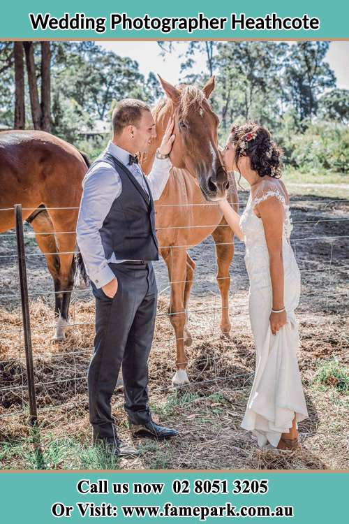 Photo of the Groom and the Bride caressing a horse Heathcote NSW 2233