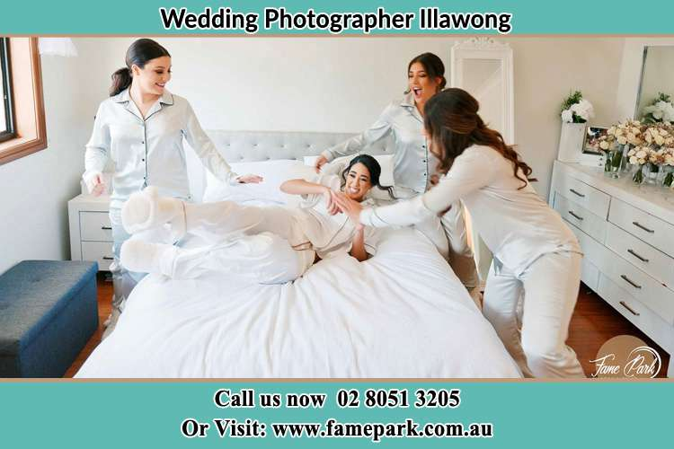 Photo of the Bride and the bridesmaids play on bed Illawong NSW 2234