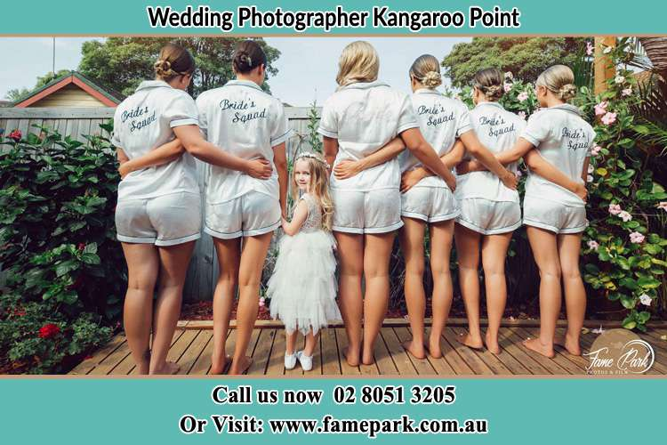 Behind photo of the Bride and the bridesmaids with the flower girl looking back Kangaroo Point NSW 2224