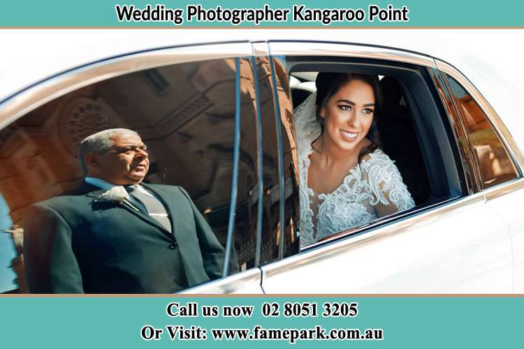 Photo of the Bride inside the bridal car with her father standing outside Kangaroo Point NSW 2224