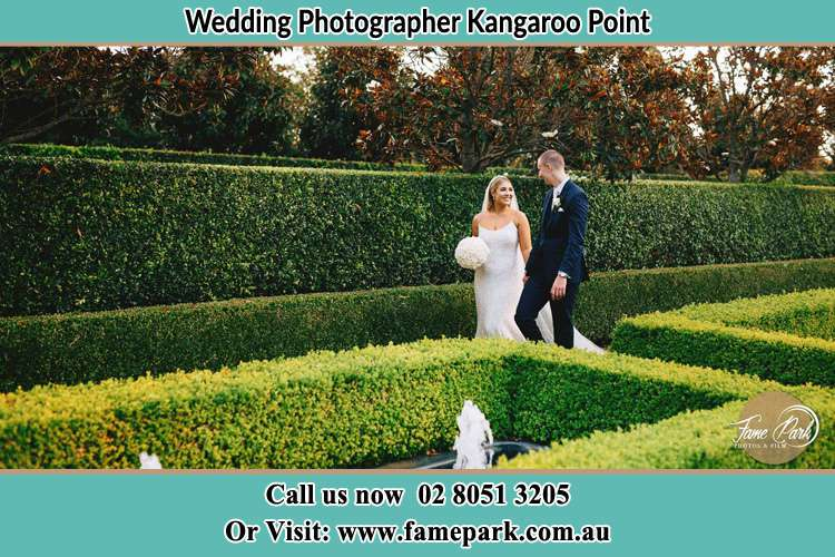 Photo of the Bride and the Groom walking at the garden Kangaroo Point NSW 2224