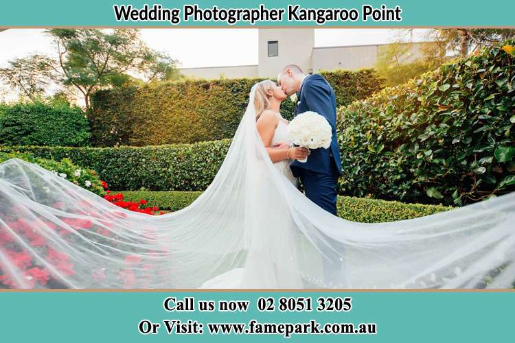 Photo of the Bride and the Groom kissing at the garden Kangaroo Point NSW 2224