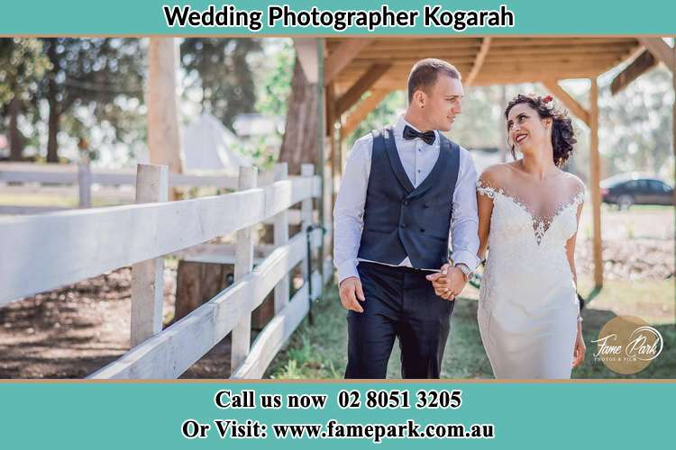 Photo of the Groom and the Bride holding hands while walking Kogarah NSW 2217