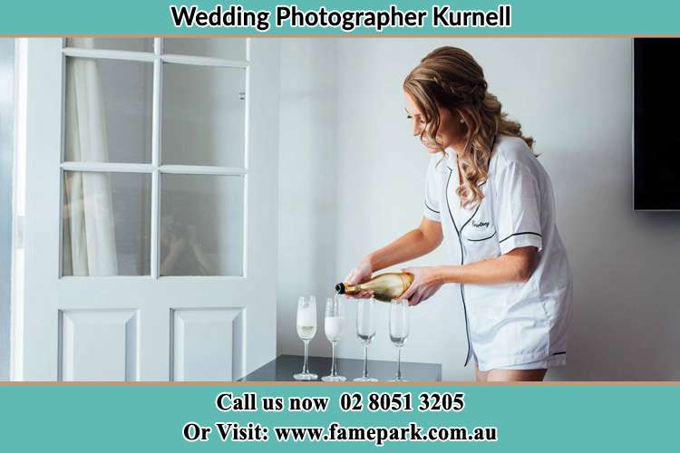 Photo of the Bride pouring wine on the glasses Kurnell NSW 2231