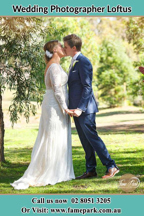 Photo of the Bride and the Groom kissing at the yard Loftus NSW 2232