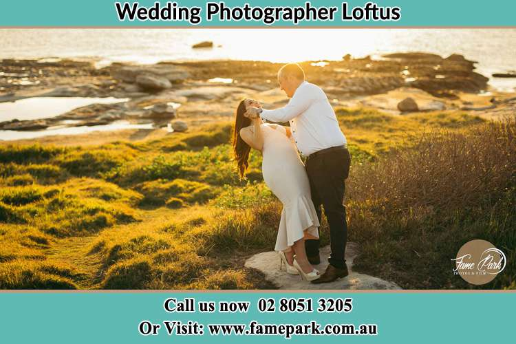 Photo of the Bride and the Groom dancing near the lake Loftus NSW 2232