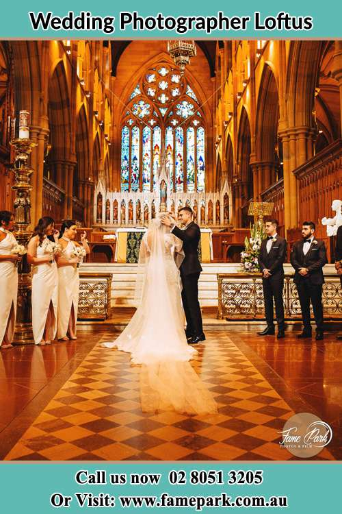 Photo of the Groom and the Bride with the entourage at the altar Loftus NSW 2232
