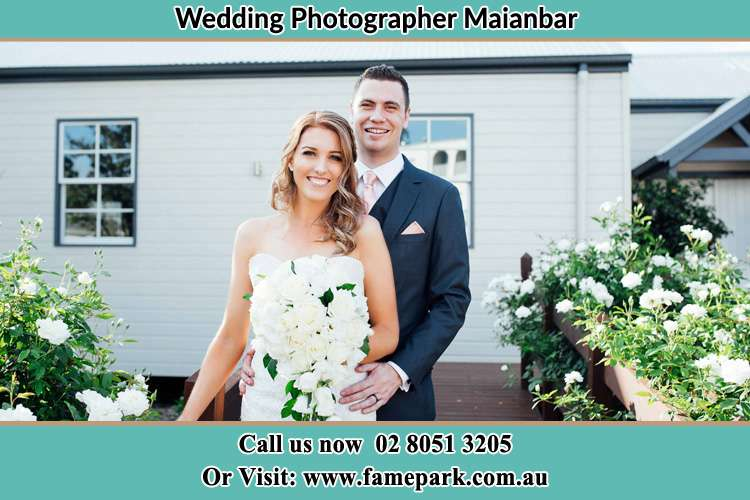Photo of the Bride and the Groom at the front house Maianbar NSW 2230