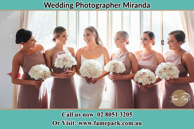 Photo of the Bride and the bridesmaids holding flower bouquet Miranda NSW 2234