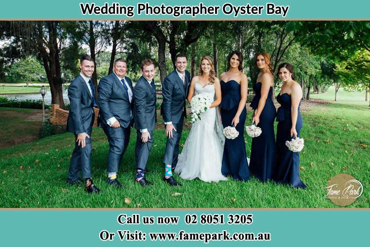 The Bride and the Groom with their entourage pose for the camera Oyster Bay NSW 2225