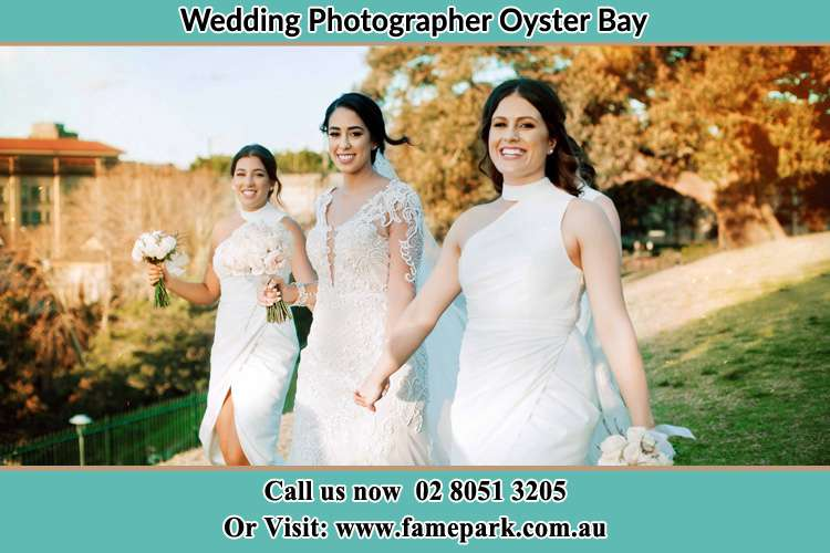 Photo of the Bride and the bridesmaids walking Oyster Bay NSW 2225