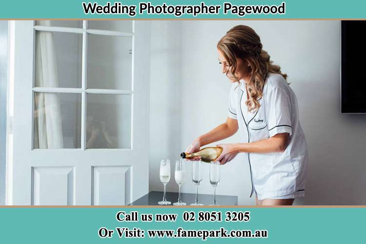 Photo of the Bride pouring wine on the glasses Pagewood NSW 2035