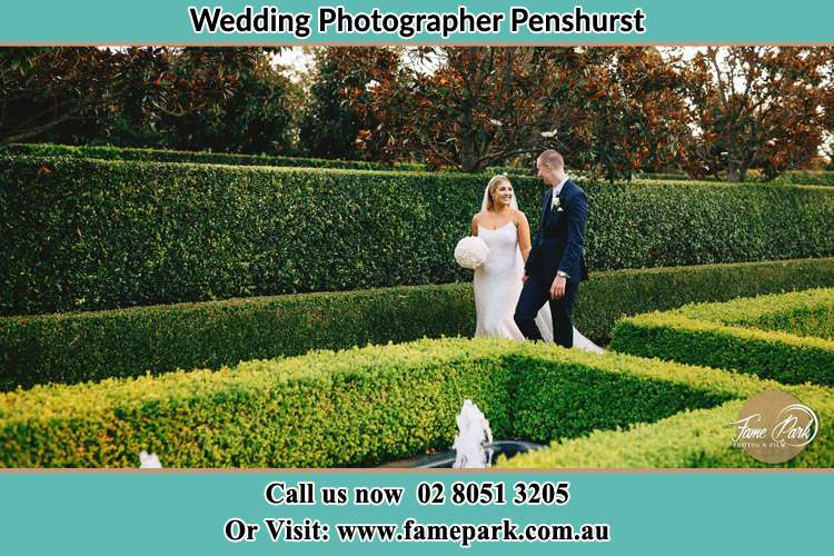 Photo of the Bride and the Groom walking at the garden Penshurst NSW 2222