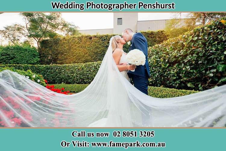 Photo of the Bride and the Groom kissing at the garden Penshurst NSW 2222