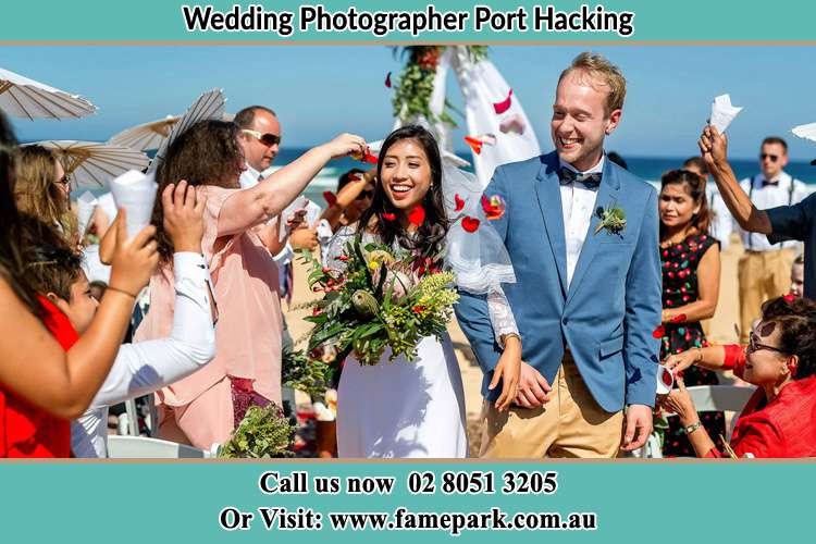 Photo of the Bride and the Groom showering flower petal by the visitors Port Hacking NSW 2229