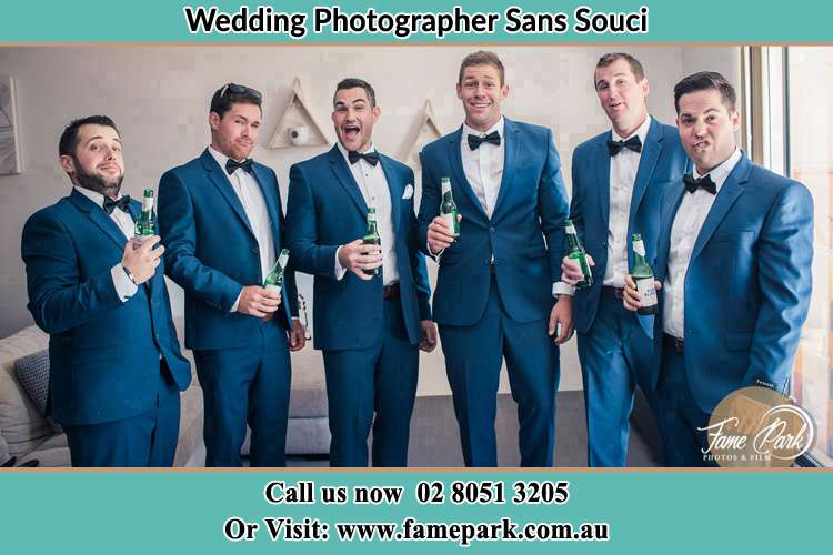 The groom and his groomsmen striking a wacky pose in front of the camera Sans Souci NSW 2219
