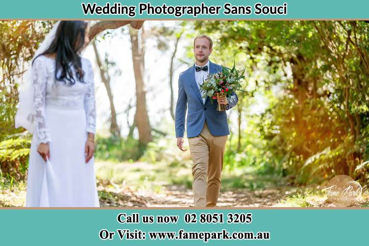 Photo of the Groom bringing flower to the Bride Sans Souci NSW 2219