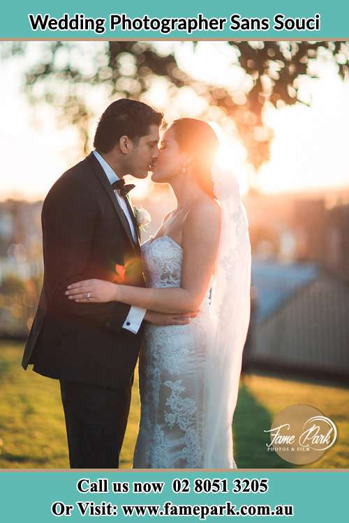 Photo of the Groom and the Bride kissing at the yard Sans Souci NSW 2219