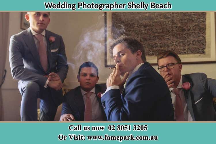 Photo of the Groom and the groomsmen relaxing Shelly Beach NSW 2261