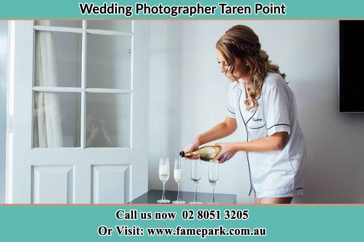Photo of the Bride pouring wine on the glasses Taren Point NSW 2229