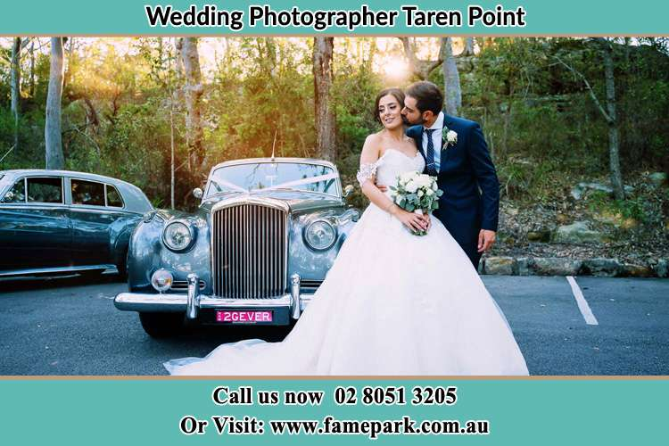 Photo of the Bride and the Groom at the fornt of the bridal car Taren Point NSW 2229