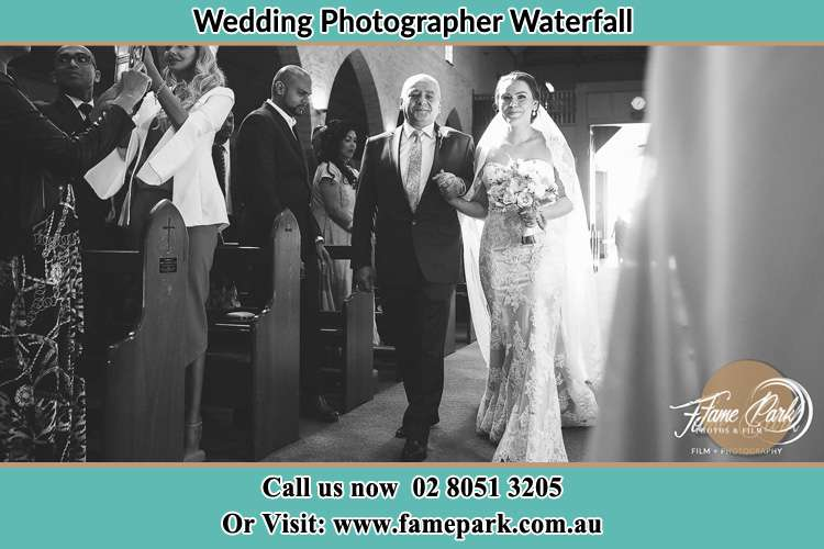 Photo of the Bride with her father walking the aisle Waterfall NSW 2233