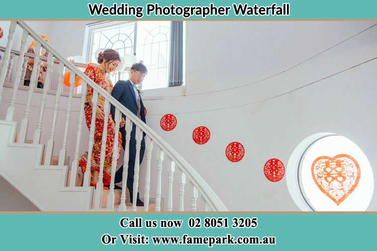 Photo of the Bride and the Groom going down the stair Waterfall NSW 2233
