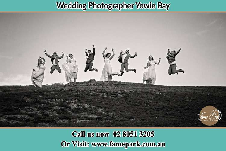 Jump shot photo of the Groom and the Bride with the entourage Yowie Bay NSW 2228